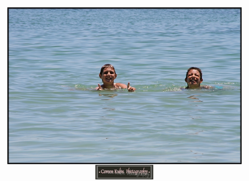 Armand and Lian having fun in the ocean at Rooiels